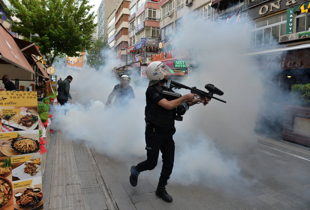 Riot police use tear gas to disperse demonstrators during a protest against the detention of two hunger-striking teachers in Ankara, Turkey, May 22, 201. (Photo by Reuters/Stringer)