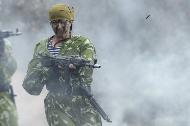 Russian female soldier performs during a rehearsal for the Navy Day parade in the far eastern port of Vladivostok, Russia, July 24, 2015. Russia will mark Navy Day on July 26. (Photo by Yuri Maltsev/Reuters)