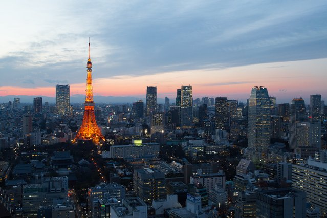 """""""Tokyo Tower at Twilight"""". Tokyo Tower inspired previous generations with hope for the future. It is the same now as it was back then. Because Tokyo Tower is one of the symbols of Japan. Photo location: Minato-ku, Tokyo, Japan. (Photo and caption by Masahiko Futami/National Geographic Photo Contest)"""