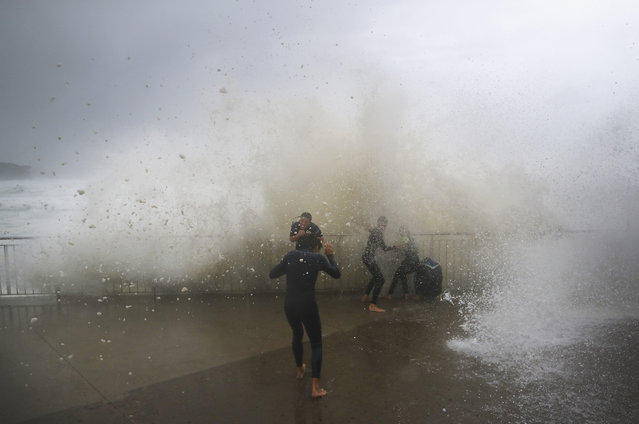 Local children are soaked by huge waves at Bronte Beach on June 5, 2016 in Sydney, Australia. The Bureau of Meteorology is forecasting up to 300mm of rain over the weekend, with warnings issued for dangerous surf and flash flooding in some areas. (Photo by Ryan Pierse/Getty Images)