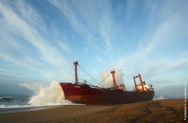 A wave brakes on the stranded TK Bremen, near Lorient, France, on December 17, 2011