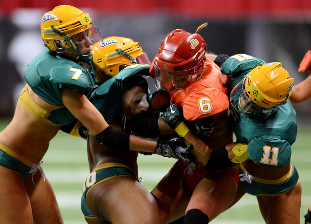 Markie Henderson #6 of the Las Vegas Sin is tackled by Elizabeth Strozinski #7, Kara Alexander #10 and Laure Gelis-Diaz #11 of the Green Bay Chill during their game at the Thomas & Mack Center on May 15, 2014 in Las Vegas, Nevada. Las Vegas won 34-24. (Photo by Ethan Miller/Getty Images)