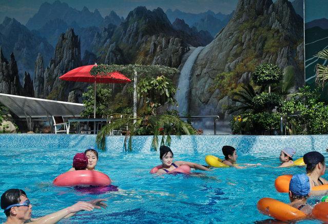 North Koreans swim in an indoor swimming pool in Pyongyang, North Korea, on March 13, 2019. (Photo by Dita Alangkara/AP Photo)