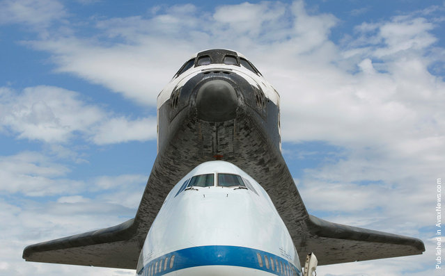 Its final flight complete, the space shuttle Discovery, sits on the Dulles International Airport tarmac under blue skies, on April 17, 2012. Discovery will be lifted from the carrier aircraft shortly, and will towed to the National Air and Space Museum's Udvar-Hazy Center for display