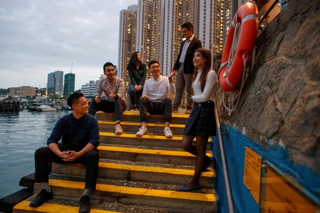 Newly elected district councillors Lee Yue-Shun, Tat Cheng, Karrine Fu, Jason Chan, James Pui and Jocelyn Chau (L-R) pose for a photo at the water front in front of the Eastern District Council building in Hong Kong, China, December 17, 2019. (Photo by Thomas Peter/Reuters)