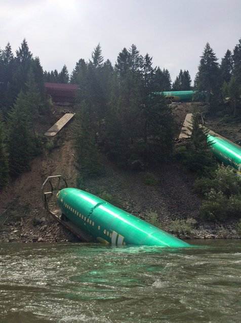 Three Boeing 737 fuselages lie on an embankment on the Clark Fork River after a BNSF Railway Co train derailed Thursday near Rivulet, Montana in this picture taken July 4, 2014. A train derailment in Montana this week damaged a shipment of jetliner fuselages and other large parts on its way to Boeing Co factories in Washington state from Spirit Aerosystems, Boeing said on Saturday. (Photo by Andrew Spayth/Reuters)