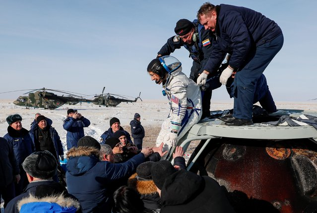 Specialists help NASA astronaut Christina Koch after landing of the Russian Soyuz MS-13 space capsule in a remote area southeast of Zhezkazgan in the Karaganda region of Kazakhstan, February 6, 2020. Koch, who led the first all-female spacewalk in 2019, landed in Kazakhstan after a record stay on the International Space Station, ending a 328-day mission expected to yield new insights into deep-space travel. (Photo by Sergei Ilnitsky/Pool via Reuters)