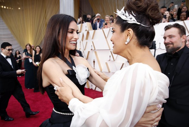Salma Hayek and Penelope Cruz embrace on the red carpet during the Oscars arrivals at the 92nd Academy Awards in Hollywood, Los Angeles, California, U.S., February 9, 2020. (Photo by Mike Blake/Reuters)