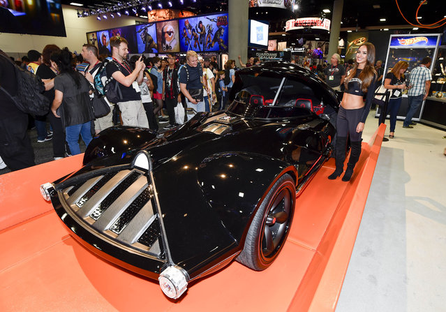Fans take photos of life sized Hot Wheels Darth Vader Mobile during preview night at the 2014 Comic-Con International Convention held  Wednesday, July 23, 2014 in San Diego. (Photo by Denis Poroy/Invision/AP Photo)