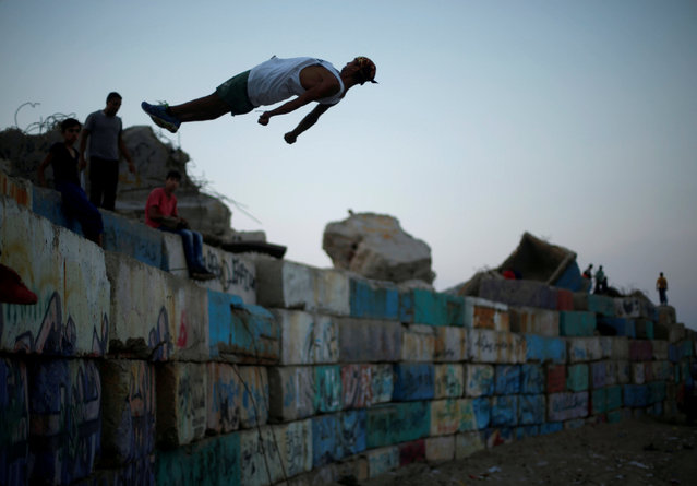 A Palestinian youth demonstrates his parkour skills at the seaport of Gaza City August 11, 2017. (Photo by Mohammed Salem/Reuters)