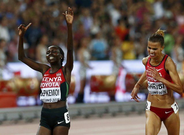 Hyvin Kiyeng Jepkemoi of Kenya (L) celebrates winning the women's 3,000 metres steeplechase final ahead of Habiba Ghribi of Tunisia (R) during the 15th IAAF World Championships at the National Stadium in Beijing, China August 26, 2015. (Photo by David Gray/Reuters)