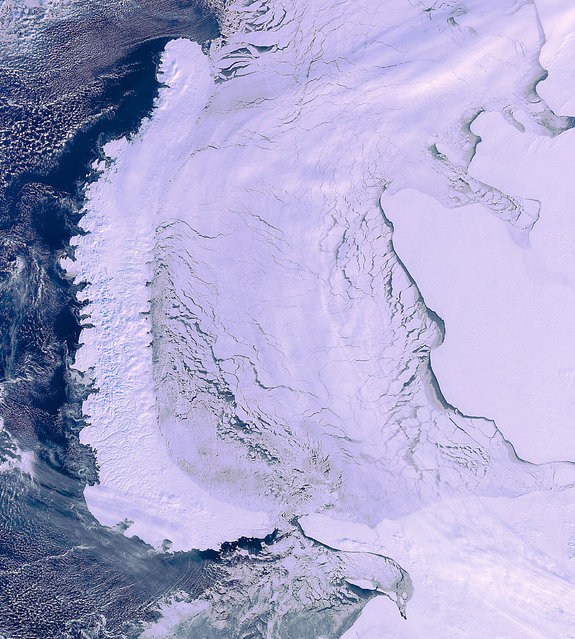 This image of the Arctic Circle was taken by Envistat a month before the ESA lost contact. The Novaya Zemlya archipelago is on the left and mainland Russia is on the right. (Photo by The European Space Agency)