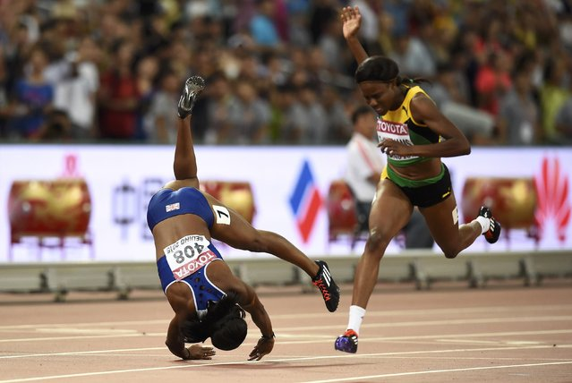 Tiffany Porter of Great Britain takes a tumble at the finish line in the women's 100 metres hurdles final during the 15th IAAF World Championships at the National Stadium in Beijing, China August 28, 2015. (Photo by Dylan Martinez/Reuters)