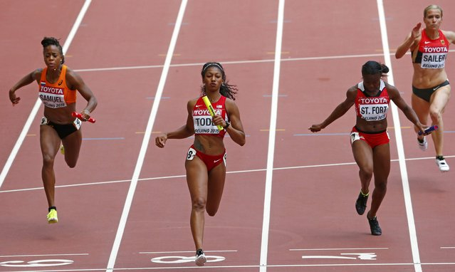Jasmine Todd of the U.S. (C) crosses the finish line as her team wins the women's 4 x 100 metres relay heat during the 15th IAAF World Championships at the National Stadium in Beijing, China August 29, 2015. (Photo by David Gray/Reuters)