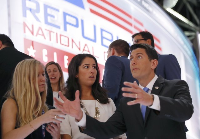 U.S. House Speaker Paul Ryan (R-Wi) poses for a photo with members of his staff on the steps of the stage during the second day of the Republican National Convention in Cleveland, Ohio, U.S. July 19, 2016. (Photo by Brian Snyder/Reuters)