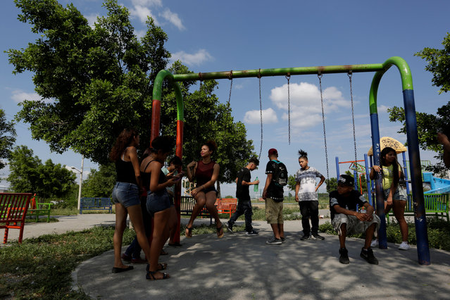 Young people, who attend the meetings of Raza Nueva in Christ, a project of the archdiocese of Monterrey, spend time at a park in the municipality of Juarez, on the outskirts of Monterrey, Mexico, June 25, 2016. (Photo by Daniel Becerril/Reuters)