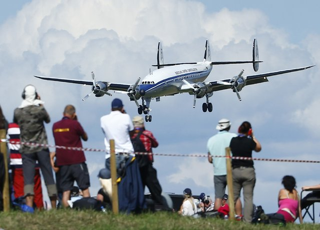 "A Lockheed Super Constellation ""Super Connie"" lands during the Air14 airshow at the airport in Payerne August 30, 2014. The Swiss Air Force celebrates their 100th anniversary with the biggest airshow in Europe this year. (Photo by Ruben Sprich/Reuters)"