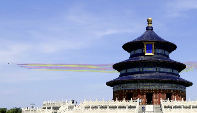 Military aircraft fly past the Temple of Heaven during the military parade marking the 70th anniversary of the end of World War Two, in Beijing, China, September 3, 2015. (Photo by Reuters/Stringer)