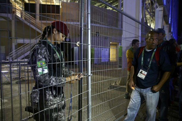 A guard locks a gate at the media entrance to the Olympics Aquatics Stadium during a security alert in Rio de Janeiro, Brazil, on August 2, 2016. (Photo by Vasily Fedosenko/Reuters)