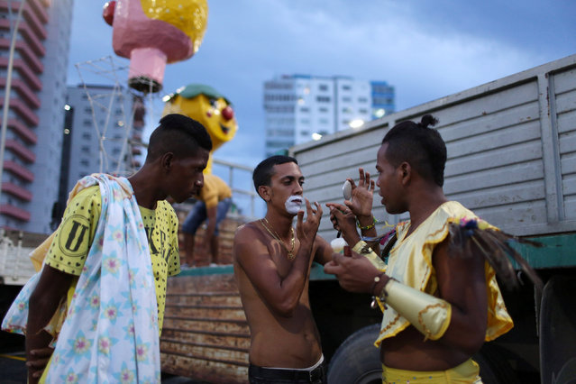 Revellers get ready at Malecon seafront before performing at a carnival parade in Havana, Cuba, August 12, 2016. (Photo by Alexandre Meneghini/Reuters)