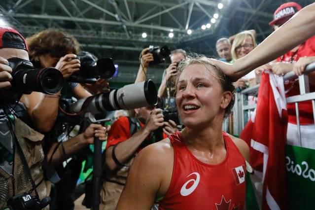 Canada's Erica Elizabeth Wiebe celebrates with fans after winning the gold medal during the women's 75-kg freestyle wrestling competition, August 18, 2016. (Photo by Markus Schreiber/AP Photo)