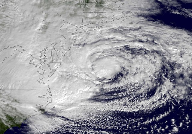An NOAA satellite image taken Monday shows Hurricane Sandy off the mid-Atlantic coastline moving toward the north with maximum sustained winds of 90 mph. (Photo by NOAA)