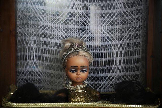 A head of a mannequin decorates a hair salon in Rabat's Medina September 21, 2014. (Photo by Damir Sagolj/Reuters)