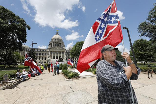 """I love this flag"", states David Flynt of Hattiesburg, while standing outside the state Capitol with other current Mississippi flag supporters in Jackson, Miss., Sunday, June 28, 2020. Lawmakers in both chambers are expected to debate state flag change legislation today. Mississippi Governor Tate Reeves has already said he would sign whatever flag bill the Legislature decides on. (Photo by Rogelio V. Solis/AP Photo)"