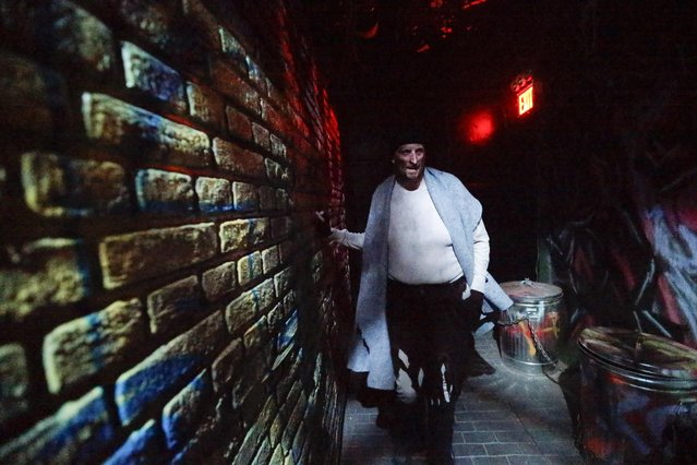 "In this October 2, 2014 photo, an actor performs during ""Nightmare: New York"", a haunted house attraction in New York. (Photo by Frank Franklin II/AP Photo)"