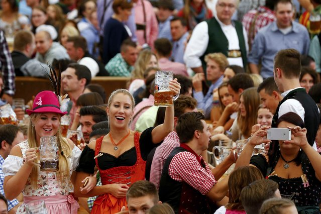 Girls cheer with beer during the 182nd Oktoberfest in Munich, Germany, September 19, 2015. (Photo by Michael Dalder/Reuters)