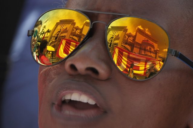 The Legislative Assembly building is reflected in the glasses of a student during a protest in San Jose October 7, 2014. Students are demonstrating against a project that aims to cut the budget of the public universities by 2015, according to local media. (Photo by Juan Carlos Ulate/Reuters)