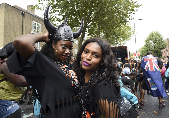 Revellers take part in the Notting Hill Carnival on August 28, 2016 in London, England. (Photo by Ben A. Pruchnie/Getty Images)