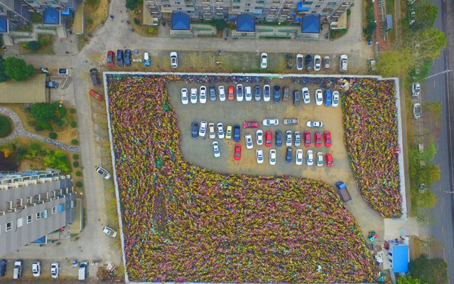 Mountain of impounded shared bikes can be seen at a parking lot in Nanjing, east China's Jiangsu Province on November 29, 2017. Although the bike-sharing services are booming nationwide in China, it's challenging to manage bike-sharing and arrange orderly parking, and some bike-sharing companies have gone bankrupt after months of problems. (Photo by Fang Dongxu/Photoshot/Avalon)