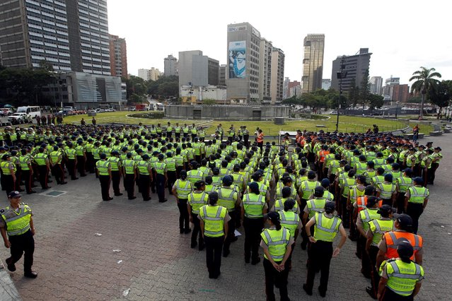 Policemen stand guard during a rally to demand a referendum to remove Venezuela's President Nicolas Maduro in Caracas, Venezuela, September 1, 2016. (Photo by Christian Veron/Reuters)