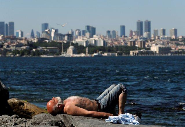 A man sunbathes by the Marmara Sea following the coronavirus disease (COVID-19) outbreak, in Istanbul, Turkey on June 28, 2020. (Photo by Murad Sezer/Reuters)