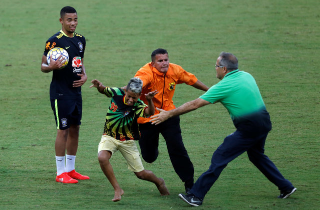 Football Soccer, Brazil national soccer team training, World Cup 2018 Qualifier, Manaus Arena Stadium, Manaus, Brazil on September 3, 2016. Security officials try to stop a boy, who ran on the field after a training session. (Photo by Bruno Kelly/Reuters)