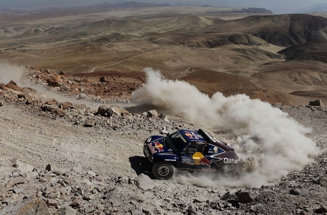 Driver Nasser Al-Attiyah of Qatar and co-driver Lucas Cruz of Spain compete in the 4th stage. (Photo by Victor R. Caivano/Associated Press)
