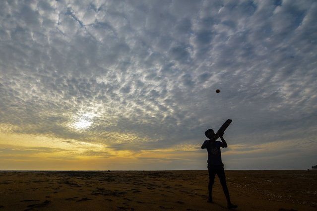 A boy play cricket on the beach Near Colombo, Sri Lanka on July 27, 2020 (Photo by Akila Jayawardana/NurPhoto via Getty Images)