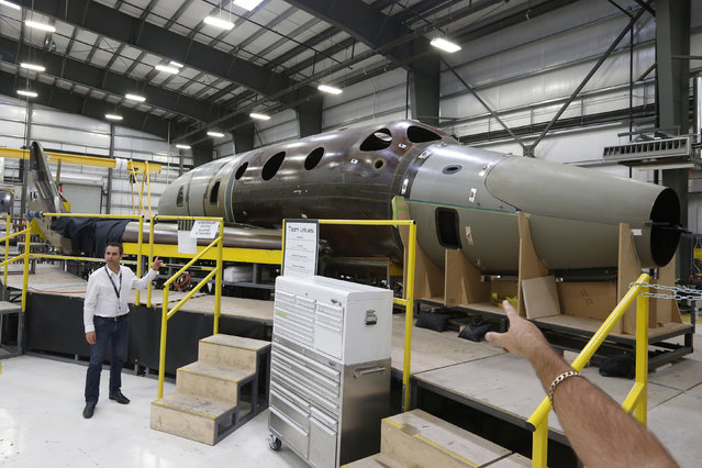 Virgin Galactic's new spaceship N202VG, which the company began building 2 and a half years ago, is seen in a hangar at Mojave Air and Space Port in Mojave. (Photo by Lucy Nicholson/Reuters)