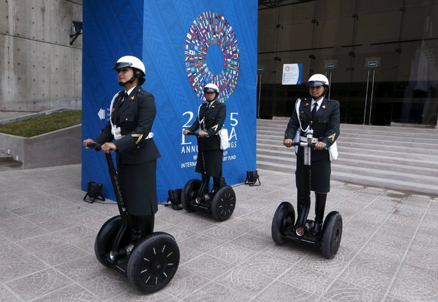 Peruvian policewomen riding two-wheeled self-balancing scooters patrol the venues of the 2015 IMF/World Bank Annual Meetings in Lima, Peru, October 8, 2015. (Photo by Mariana Bazo/Reuters)