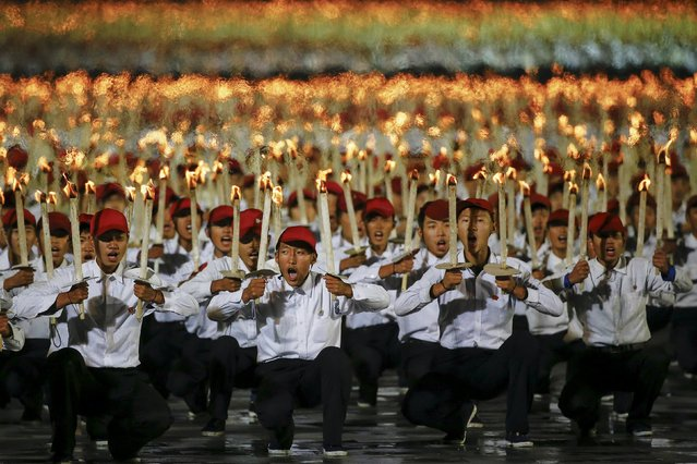 Performers with torches shout slogans during celebration of the 70th anniversary of the founding of the ruling Workers' Party of Korea, in Pyongyang, North Korea October 10, 2015. (Photo by Damir Sagolj/Reuters)