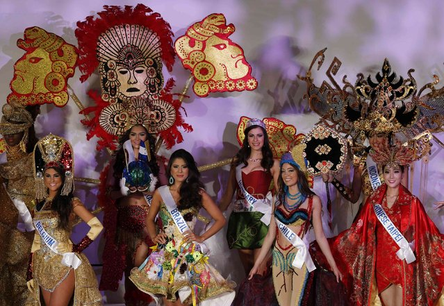 Participants pose for pictures in national costumes during the 54th Miss International Beauty Pageant in Tokyo November 11, 2014. (Photo by Thomas Peter/Reuters)