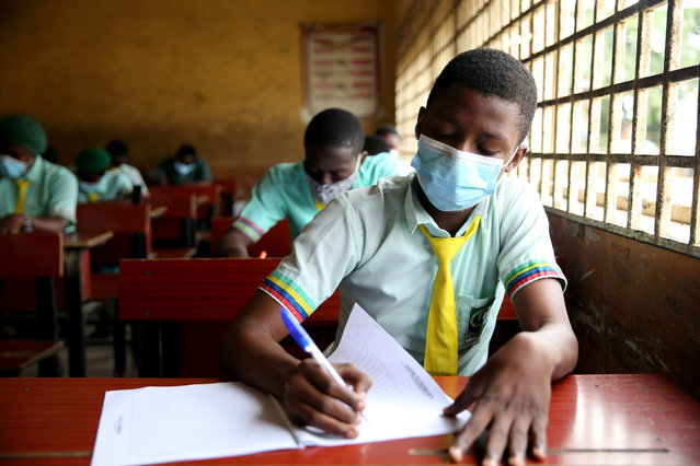 A student of Babs Fafunwa Millennium Senior Secondary school wears a face mask as she writes an examination in Ojodu district in Lagos, Nigeria 26 August 2020. Earlier this month, the Federal government of Nigeria announced the re-opening of schools for exiting students in their final year to enable them write West African Examination Council examination, after a five-month school closure to curb the spread of the coronavirus disease. (Photo by Akintunde Akinleye/EPA/EFE/Rex Features/Shutterstock)