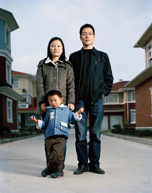 Sun Liping (28), Huang Kunhua (27) and Huang Jingxuan (4). Accountant (Sun), Administrator (Huang). One Child Family in the richest village of China. Huaxi, Jiangsu. (Photo by Mathias Braschler and Monika Fischer)