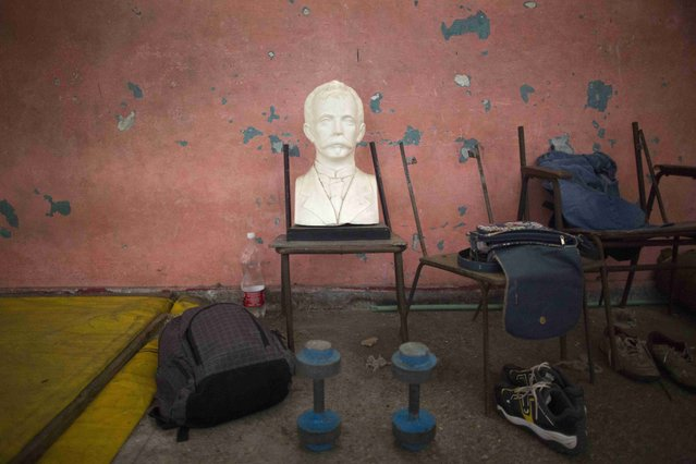 A bust of Cuban independence hero Jose Marti at a wrestling academy in downtown Havana, November 15, 2014. (Photo by Alexandre Meneghini/Reuters)