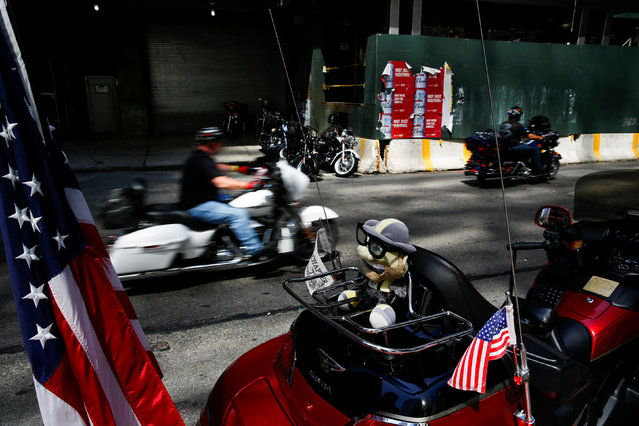 """Bikers take part in the America's 911 Ride """"The Final Ride"""", in commemoration of the 15th anniversary of the 9-11 attacks in Lower Manhattan, New York, U.S., August 21, 2016. (Photo by Eduardo Munoz/Reuters)"""
