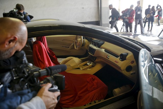 Members of the media film one of two Ferraris that were given to former Spanish King Juan Carlos as a gift from the United Arab Emirates in 2011, as they were presented to the press before being auctioned, in Madrid, Spain, October 19, 2015. (Photo by Andrea Comas/Reuters)