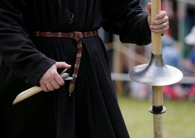 A broken lance used in a jousting tournament is picked up off the field during the St Ives Medieval Fair in Sydney, one of the largest of its kind in Australia, September 24, 2016. (Photo by Jason Reed/Reuters)
