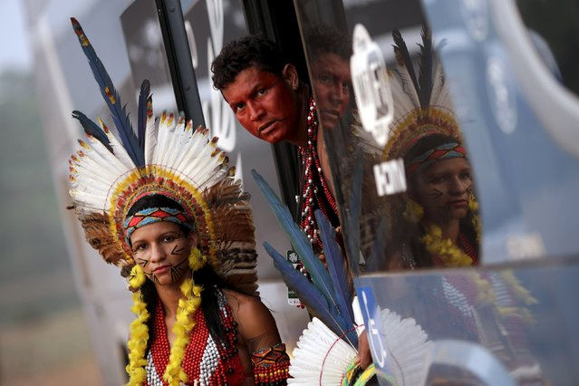 Indigenous people from the Pataxo tribe look out of a bus as they arrive to participate in the I World Games for Indigenous People in Palmas, Brazil, October 20, 2015. (Photo by Ueslei Marcelino/Reuters)