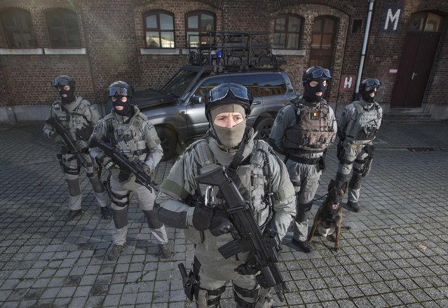 Members of Belgium's special forces pose for pictures at their headquarters in central Brussels November 24, 2014. Human rights monitors say police in Belgium are legally entitled to use proportionate force, after a warning, where there is no other means to achieve a legitimate objective. They say police may use firearms in self-defence, to confront armed perpetrators, or in defence of persons or key facilities, but never for crowd control. (Photo by Yves Herman/Reuters)